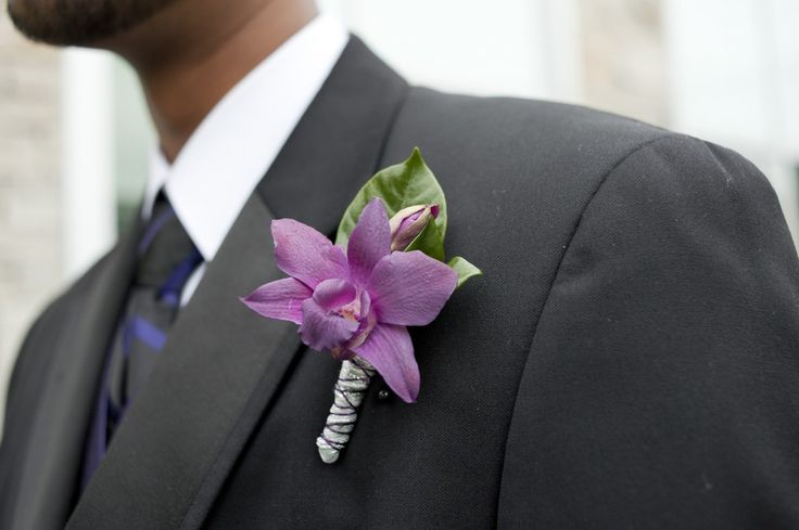 Love this boutineer/boutonniere! Just a pop of the light purple orchid because I think, for the wedding, the guys will be in gray suits, but lighter than this gray.