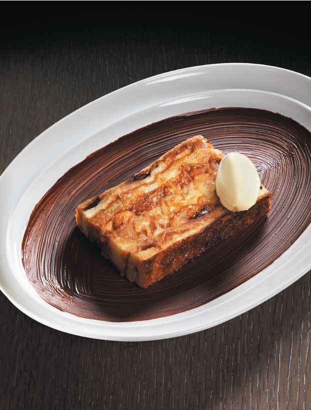 Caramelized Banana Bread and Butter Pudding from Marcus Wareing's The Gilbert Scott Book of British Food. This is a pudding that always gets rave reviews in the restaurant, because it combines three irresistible components: brioche, bananas and custard. http://thehappyfoodie.co.uk/recipes/caramelized-banana-bread-and-butter-pudding
