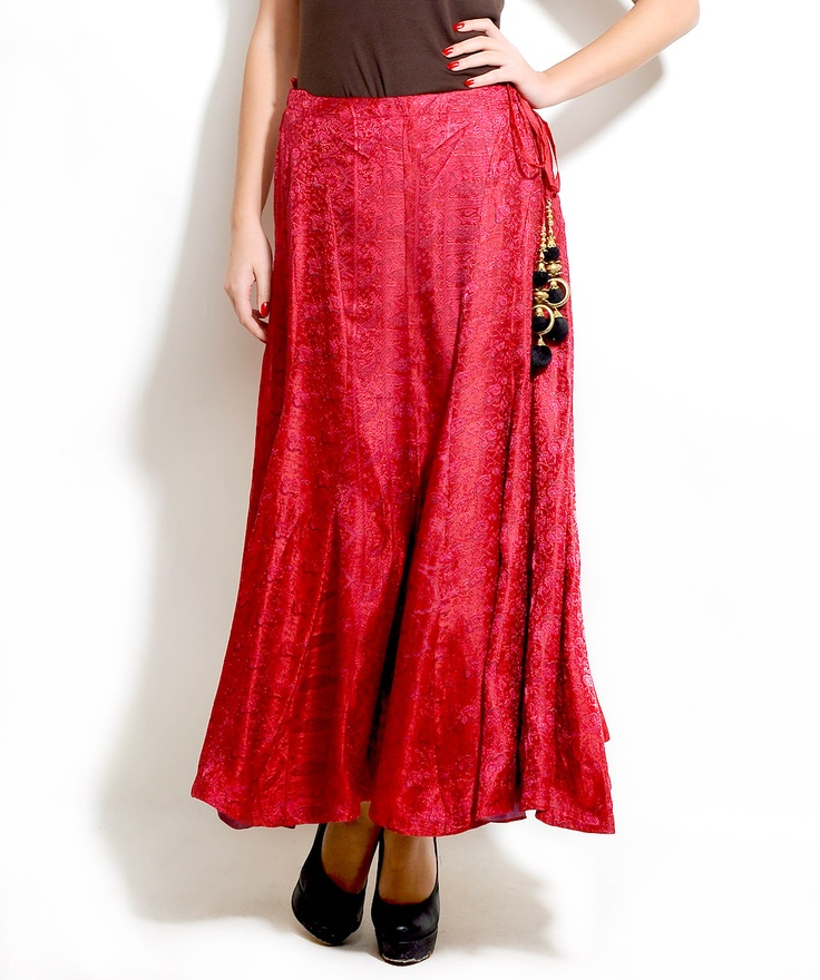 Pink Brocade Skirt    Design Highlights:   -Beautiful brocade skirt with rich panels  -Uneven hemline with fastening provision on the waist  -Pompom and metal disk and beads attached to the thread  -Concealed zipper at one side