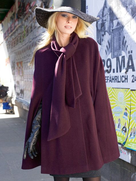 Burda 122.  Women's cape sewing pattern available for download. Available in various sizes and is produced by burda style magazine.  This stylish cape will keep you warm in style, and is a great piece for transitional fall weather. The large attached scarf is cozy and can be worn in multiple ways to complement your outfit.
