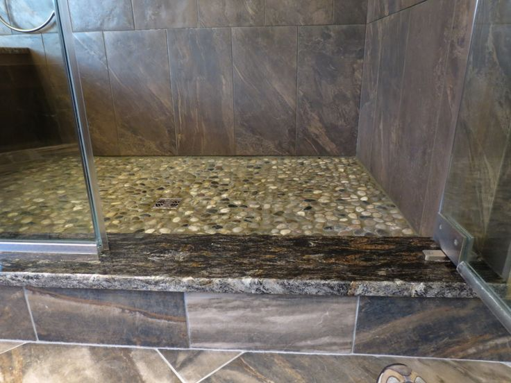 Tile baseboard comes up to the granite shower threshold for Marble threshold bathroom