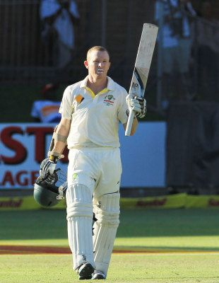 Chris Rogers raises the bat after reaching his hundred, South Africa v Australia, 2nd Test, Port Elizabeth, 4th day, February 23, 2014