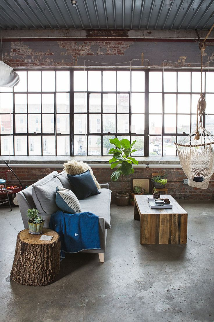 loft studio apartment, rustic, grey sofa, hammock swing chair // Chelsey Cobbs' Oklahoma City Studio Apartment Tour #theeverygirl