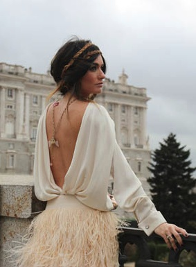 open back + feathered skirt.