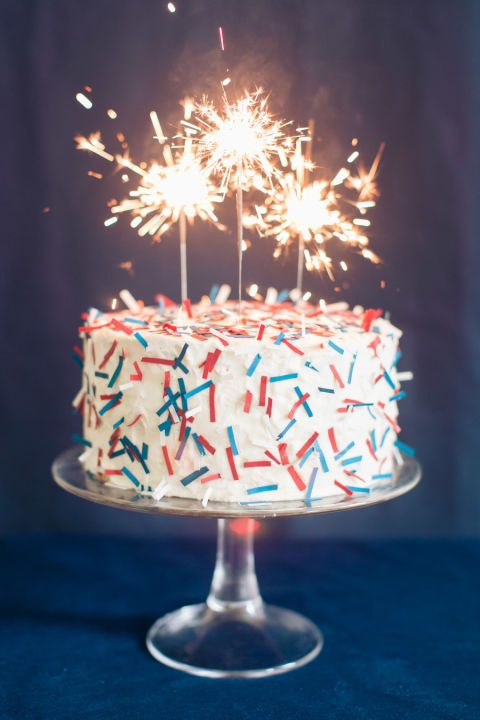 Sparkler Cake: Take a basic boxed cake recipe to the next level with confetti-inspired sugar sheets and firework sparklers. For more fun 4th of July party ideas, click through!