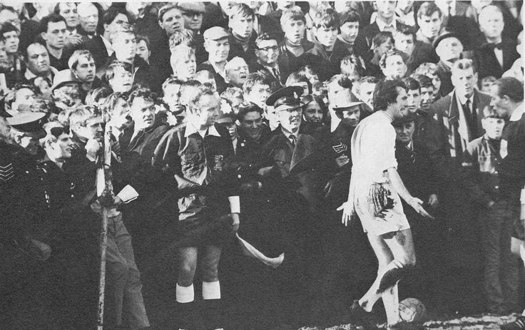 8th March 1969. Leicester City winger Len Glover asks for the referee's help in taking a corner as the Mansfield Town supporters edge closer to the pitch, in their FA Cup Quarter Final.