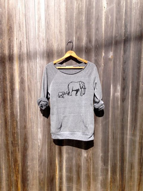 i print a BLACK mama and baby ELEPHANT onto a Super Soft Sweatshirt that has a wide, raw edge neck. the sweater is soft, comfy and flirty. the