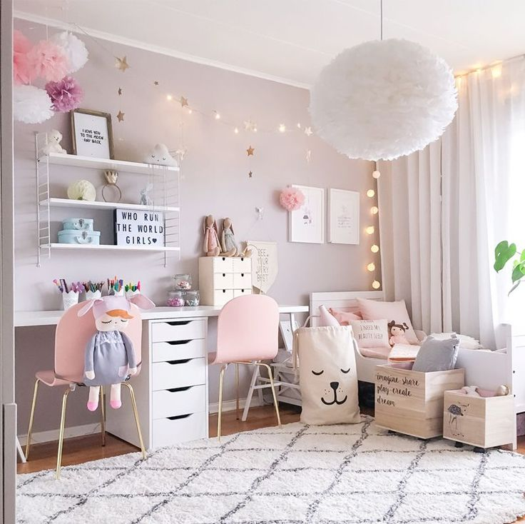A gorgeous Scandinavian inspired style Shared Girls Room - dusty pink walls, fluffy rug and cushions, pom poms, girly décor, white and grey accents