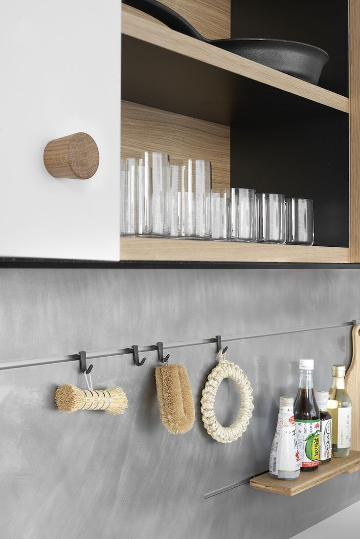 """""""We made a big effort to design useful accessories,"""" says Morrison. The stainless back panel can be customized to hold varnished steel hooks, shelves, a paper towel dispenser, cookbook holder, sponge drainer, and more. In oak, Morrison's designs include a knife block, wine glass holder, spice rack, and cutting board."""