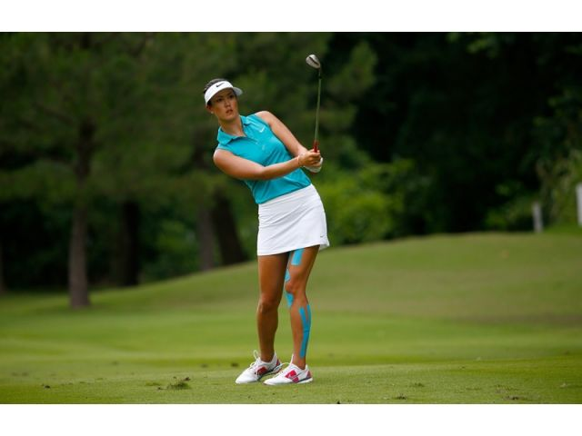 Michelle Wie killing it with her coordinated kinesiotape! Walmart NW Arkansas Championship Photo Gallery   Golf Channel