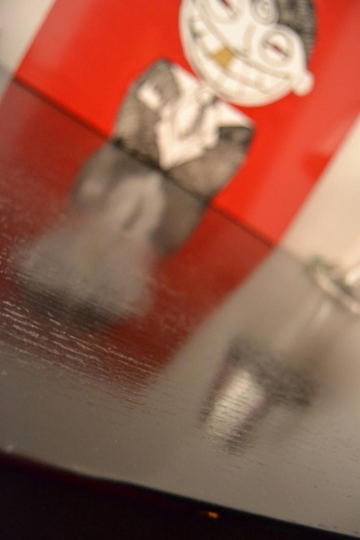 black desk + red artwork
