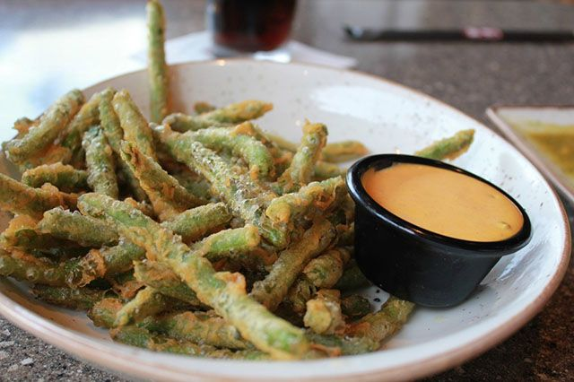 A copycat recipe from PF Changs. Pf chang's crispy green beans is prepared with fresh long beans, well coated with egg, flour mixture, deep frying in oil to make it crispy outside. Served with ranch dressing mixture dipping sauces. Ingredients…