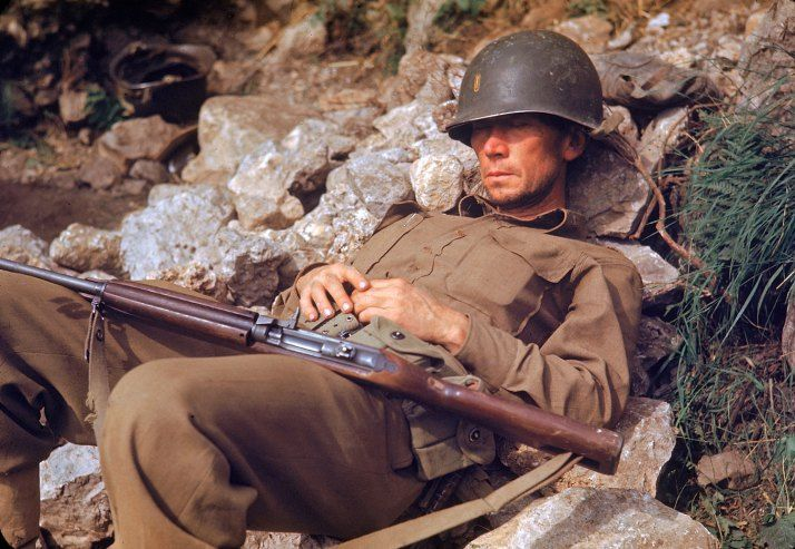An American soldier sleeps on a pile of rocks during the drive towards Rome, 1944.  Carl Mydans—Time & Life Pictures/Getty Images