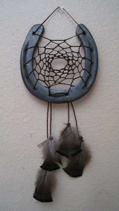 Horse shoe dream catcher for sale! I think this would be fairly easy to DIY. I know how to make dreamcatchers and it doesnt look too much harder than regular dreamcatchers. It would look great in the barn!