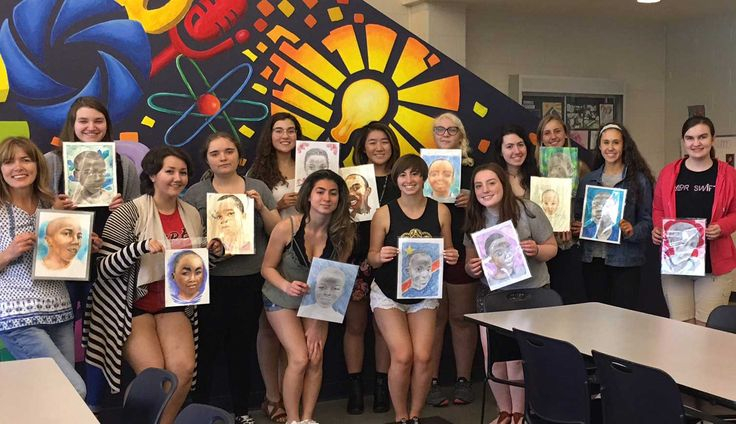 """Shelley Ortner, NJ high school art + design teacher had her students participate in the """"memory project""""  after learning about it in one of her UF art ed courses. She writes """"We were given photos of children from the Congo and sent our portraits back on June 1st. The students and I found the whole process very rewarding and we are excited to receive the video when they are presented to the children."""""""