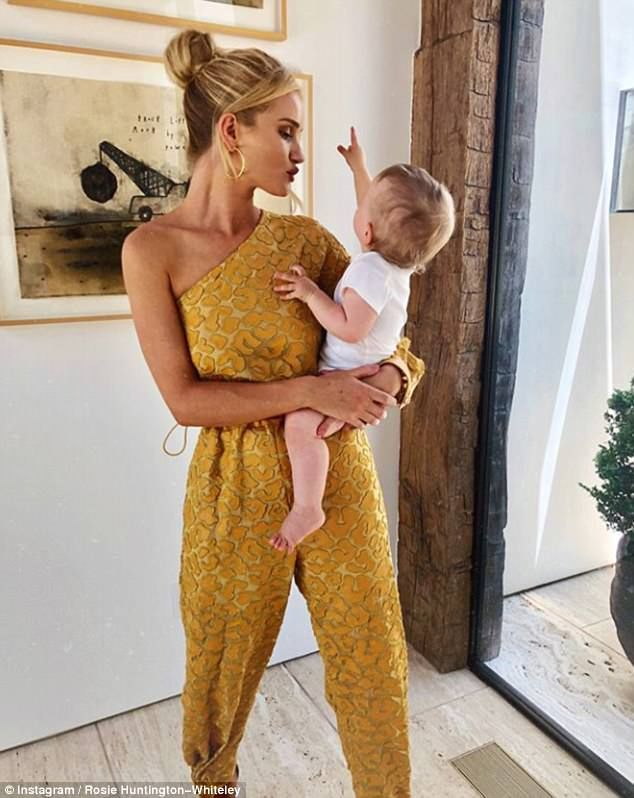 c03a46b2694 ... The 31-year-old supermodel cooed over her son as she posed for the  social media snaps