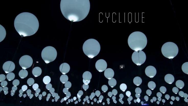 Cyclique est une installation composée d'une matrice de 256 ballons gonflés à l'hélium. Les ballons équipés de LEDs sont les interprètes d'une composition musicale et lumineuse. Se transformant en une sculpture cinétique aérienne  Cyclique évolue au gré du vent et transporte les spectateurs dans des paysages artificiels synesthésiques.  Direction - Scénographie - Conception: Maxime Houot Production: Collectif Coin