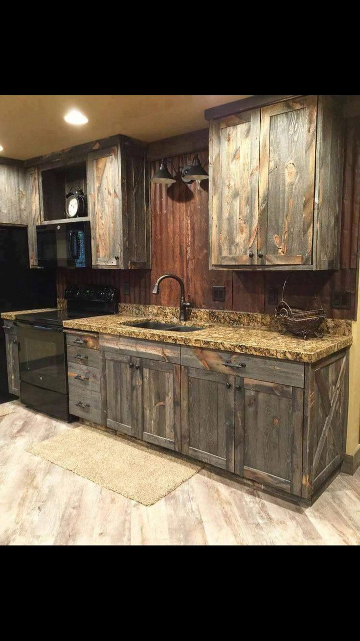 I like the wood on these cabinets, but the overall darkness is too much for me.