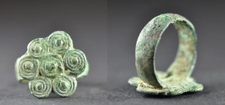 Amlash bronze ring with spirals 4, 1st millenium B.C. Amlash bronze ring with spirals, 1.9 cm long bezel, 1.8 cm diameter ring size, 6.1 gr weight. Private collection