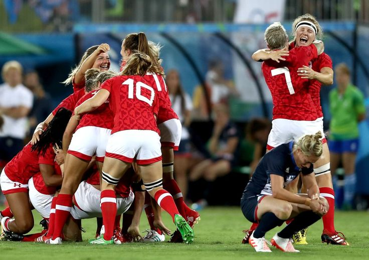 <p>Team Canada celebrates their victory winning the Bronze medal after the Women's Bronze Medal Rugby Sevens match between Canada and Great Britain on Day 3 of the Rio 2016 Olympic Games at the Deodoro Stadium on August 8, 2016 in Rio de Janeiro, Brazil. (Photo by David Rogers/Getty Images) </p>