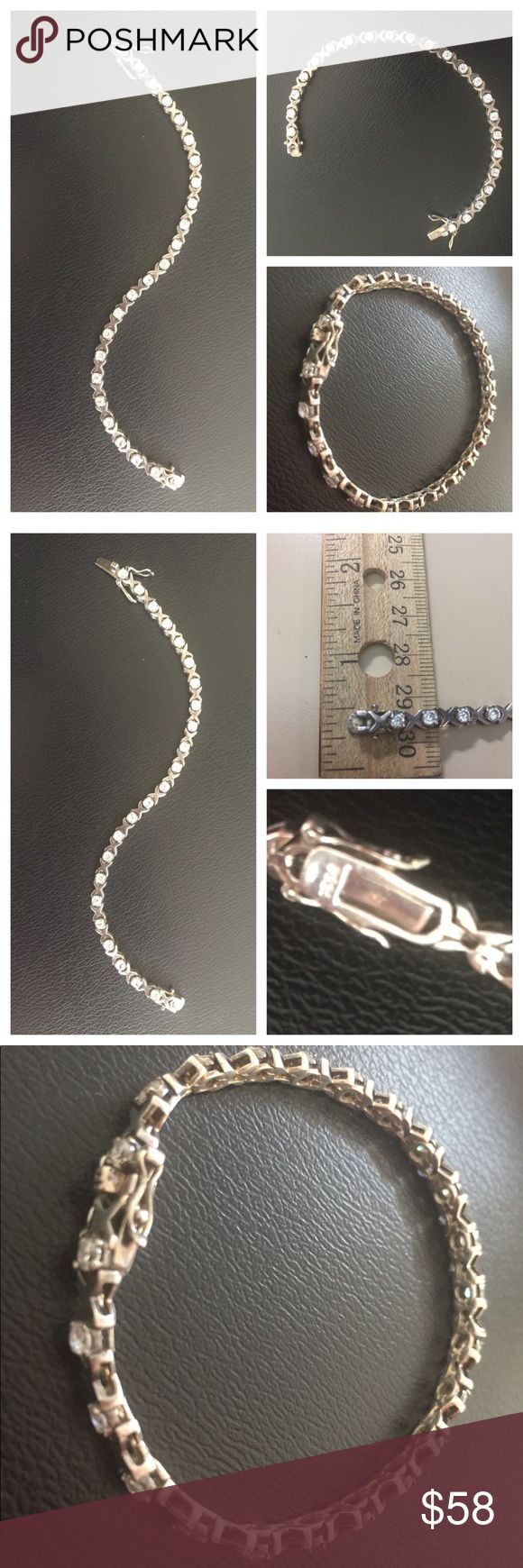 """Vintage 925 Sterling Silver Tennis Bracelet Beautiful stamped 925 Sterling Silver Tennis Bracelet featuring round cubic zirconia's in an X and O setting. Push-in double safety latch closure. Measures 7"""". In excellent preowned vintage condition. No missing stones and no issues. Vintage Jewelry Bracelets"""