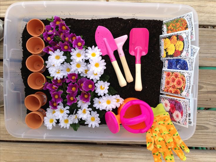 Made a gardening sensory bin for Chloe! Potting soil, seed packages, Mini pots, tools, gloves, watering can and fake flowers!