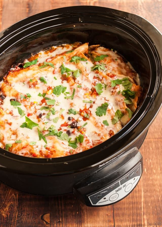 An easy recipe for slow cooker enchiladas with black beans and cheese. Vegetarian.