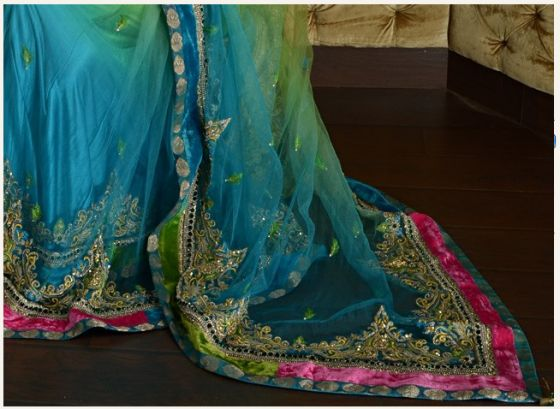 This peacock colored sari in net is amazing. Look at the {parrot and lime greens, peacock blues, and the hint of magenta and pink}. <!--more--> Oh my goodness. The dabki blouse is even more beautiful. Can I say I love you to a sari? Because I do. The price is a bit of a whopper at $2,245 but if you are looking for a stellar wedding [...]