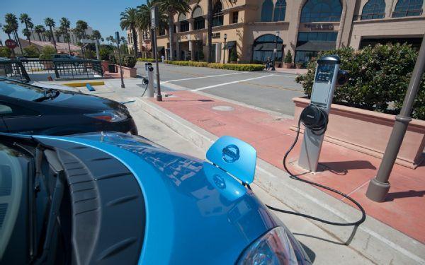 2011 chevrolet volt 2011 nissan leaf 2011 toyota prius charging station