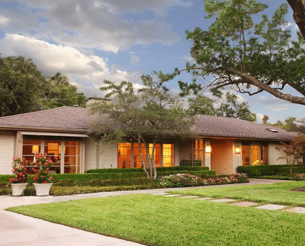 Really pretty. Like the brick colors, landscaping. A ranch home remodel.