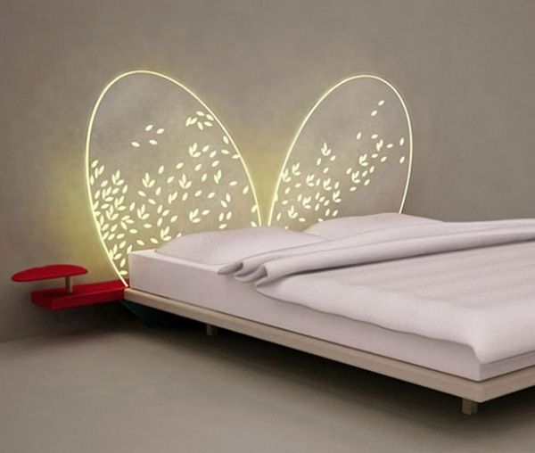 LOVE LOVE LOVE THIS  Mariposa.This headboard is made of a thin sheet of methacrylate and has the shape of some beautiful wings which are illuminated