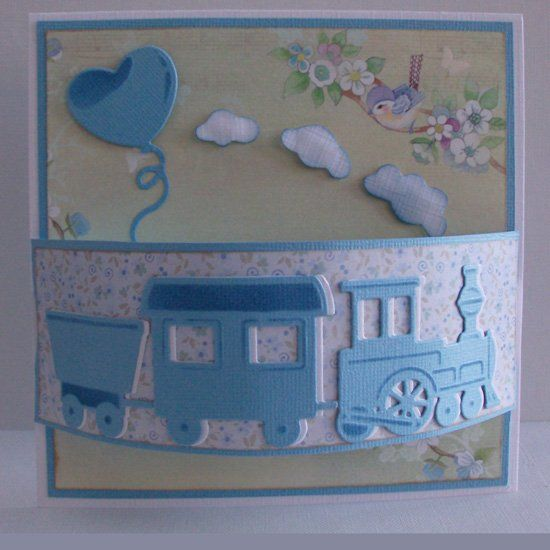 handmade baby boy card from Card Gallery - Marianne Design dies ... cute train double cut in blue and white, attached off-set to make some extra dimension .. fun layout also has a wide band raised like a bridge over the card ... luv it!