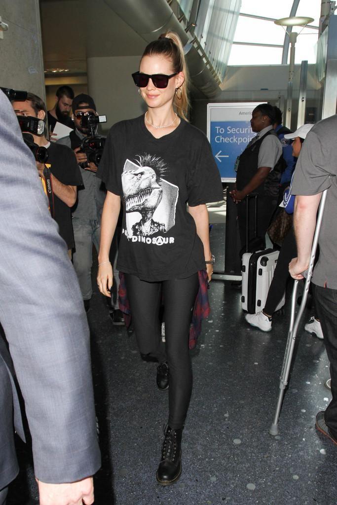 Behati Prinsloo wearing Dr. Martens 1460 8-Eye Boots in Black and Rails Hunter Plaid Shirt
