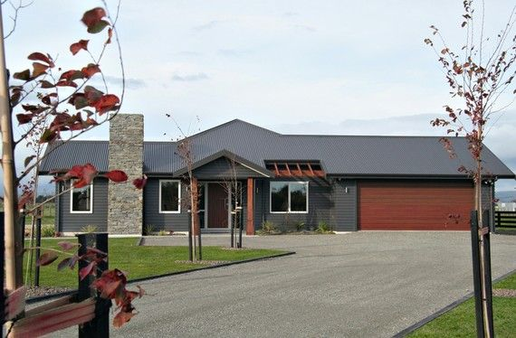 Like this combo of dark weatherboard with small wood and stone accents. (Linea Weatherboard)