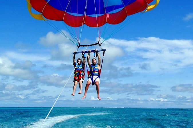 Punta Cana Parasailing Tour  Have you ever dreamed of flying in the sky? Here's your opportunity: Parasailing.Your parasail will be safely secured to a speed boat that will cruise along Punta Cana's coastline. Get spectacular, bird's eye views of Punta Cana with its turquoise waters and palm tree studded beaches.Simply put: A breathtaking experience.Imagine being raised 150 feet in the air, the cool wind caressing your face while relaxing with a spectacular view of the coast o...
