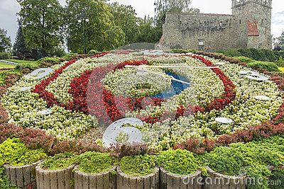 Flower clock in Nowy Sącz  in the Parknext the defensive wall , fortres ,Poland