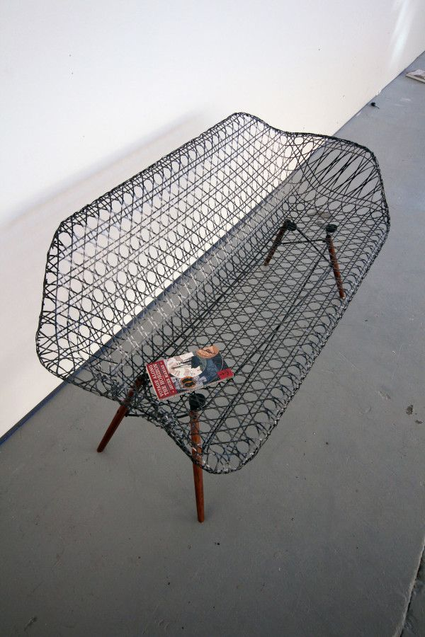Architect and designer Matthew Strong created this homage to the Eameses with a sculptural carbon fiber Eames sofa