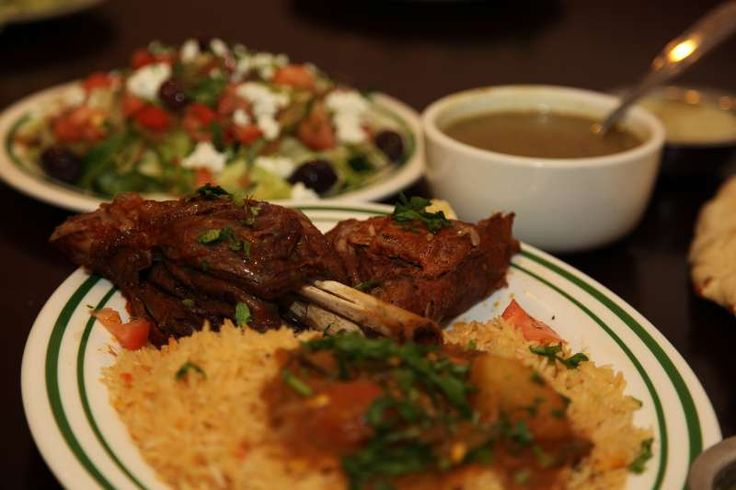 Grilled baby lamb chops , served over a bed of long grain basmati rice & topped with a vegetable sauce.