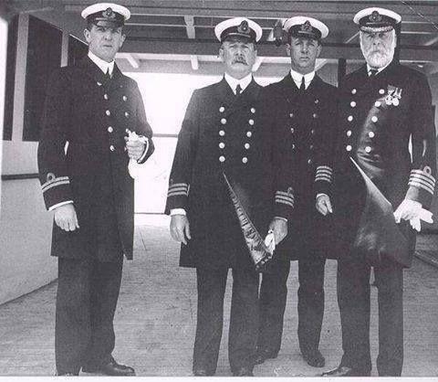 Original crew of Titanic, Captain standing on the right.