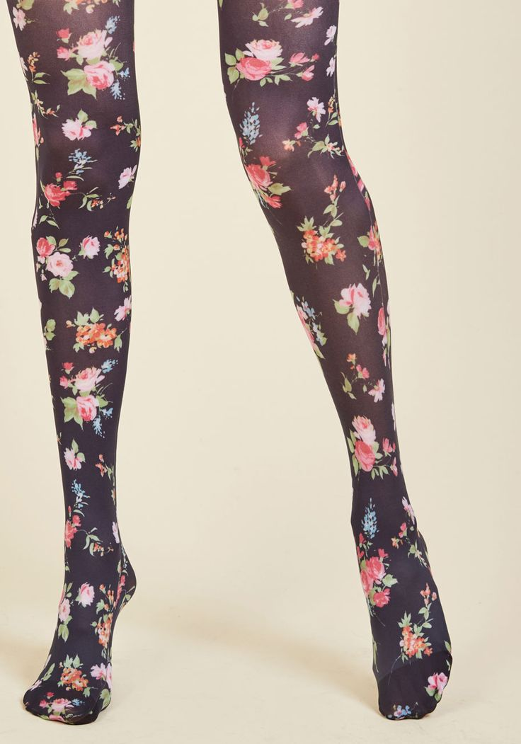 Botanical Brio Tights | Mod Retro Vintage Tights | ModCloth.com Your most robust looks always incorporate a floral element, and these muted navy tights are just the ticket to another strong ensemble! Bedecked with green, pink, blue, and orange flowers from waist to toe, this feminine hosiery caters directly to your penchant for petals.