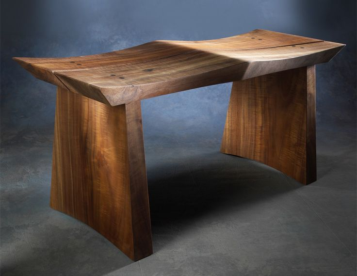 This massive yet graceful original design is handmade of orchard-salvaged claro walnut from groves in Northern California which have been slated for removal. This wood is often grafted with english wa