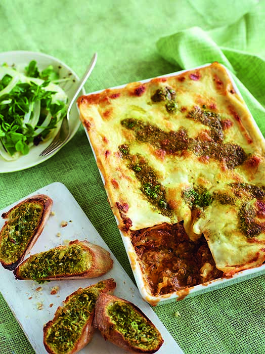 Italian American lasagne and garlic baguette - Make our new take on garlic bread as cheesy as you like. The pesto in the lasagne adds a delicious herby twist too!