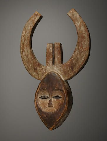 Sold for US$ 100,000  Fine and Rare Kwele Mask, Gabon