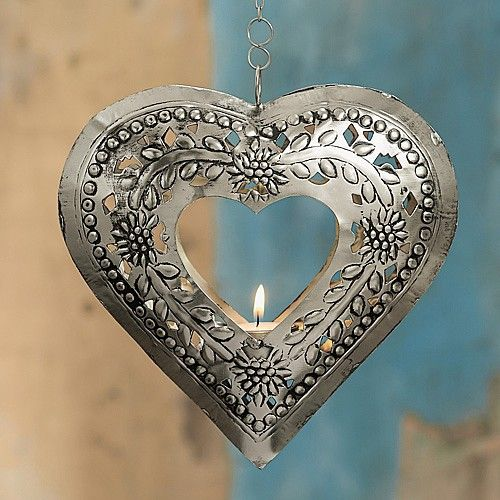 £9.99 Hanging Heart Tealight Punched metal tealight holder on 46cm long chain, recalling the glowing lanterns of Playa del Carmen's street stalls.