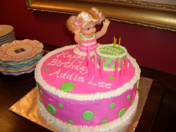 Baby Doll Party Birthday Cake  (i'm thinking I'll do a cake like this, but with 2 baby dolls on it for my girls!)