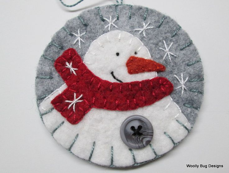 Wool Felt Snowman Ornament, Red Scarf, Gray Swirl Button, Handstitched Snowflakes. $10.50, via Etsy.