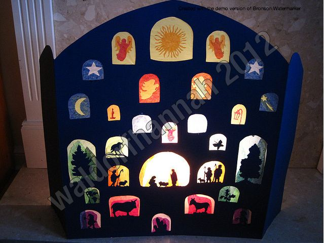 a silhoutted back-lit nativity scene with tissue paper