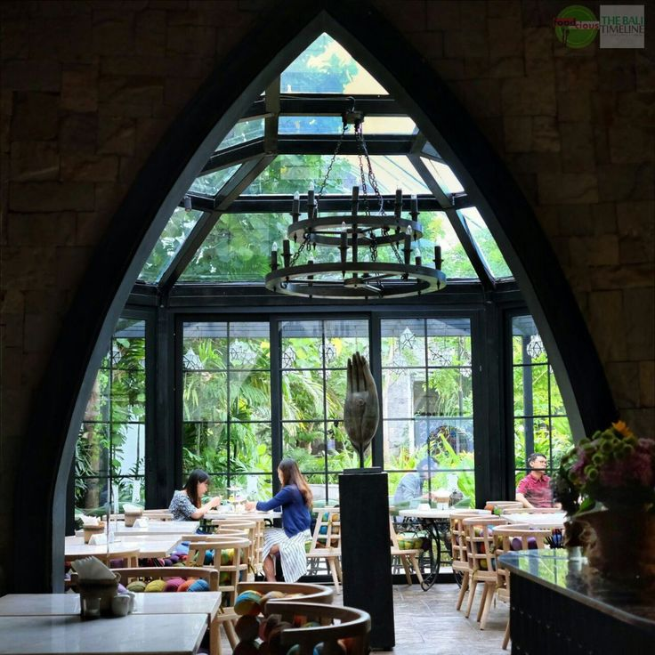 "You might notice this bistro from pictures posted in social media, their mid-century European Gothic interior seems pretty interesting and so ""Instagram-able"", specially their glass house at the back that looks like a greenhouse with all the lush plants on the outside."