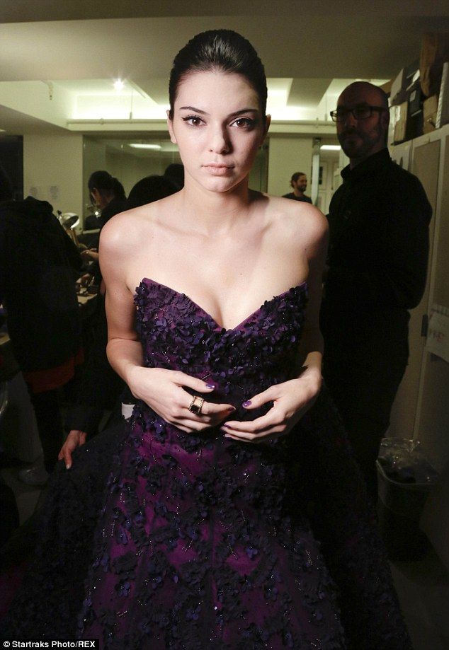 Finishing touches: Kendall completed the look with a giant ring on her index finger and purple nail polish