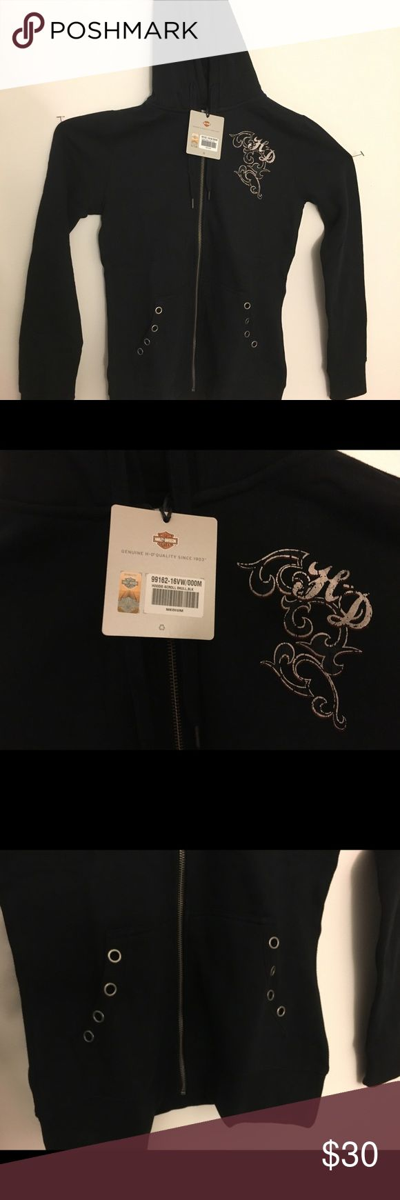 Brand New Harley-Davidson® Women's  Hoodie, Black Harley-Davidson® Women's Embellished Scroll Skull Hoodie, Black 99162-16VW  Made of 60% cotton and 40% polyester sweatshirt fleece Zipper front with rhinestone accented pull and lined drawstring hood Rib-knit cuffs, waist, and pocket trim Kangaroo-style pockets.  Eyelets on pocket trim Printed metallic graphics on left chest and back.  Printed skull graphics with mixed stud embellishment on back Harley-Davidson Tops Sweatshirts & Hoodies